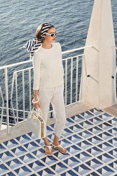 French riviera style - all white with blue patterned accents and retro sunglasses