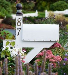 Surrounding your mailbox with flowers instantly makes your front yard more welcoming and approachable. Combine easy-growing varieties such as anise hyssop, sedum, phlox, aster, and shrub rose for the lush, relaxed appearance that characterizes cottage garden style.