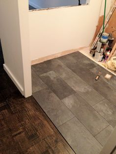 The kitchen floor looks like slate but its really a Pergo textured laminate floor. My goal was to avoid using a tile guy and take full a...
