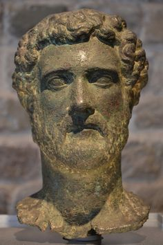 Bronze head of the Emperor Antoninus Pius, who ruled from 138-161 CE. (Photo taken by Carole Raddato at the Romisch-Germanisches Museum, Cologne) -- Ancient History Encyclopedia