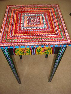"Painted Table by cosetsbest on Etsy -- I like the idea of lines of images encircling--or should I say ""ensquaring"" -- the center. Nice."
