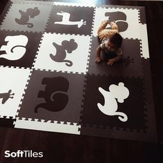Stylish SoftTiles Safari Animals play mat in black, gray, and white is perfect for the monochromatic playroom! #playroom #softtiles #playroomdecor #kidsroom #nursery #nurserydecor