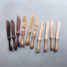 Carved butter knives available in walnut and curly maple. Select wood below.