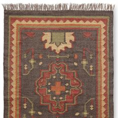 A muted charcoal provides becoming contrast to the persimmon-colored medallion that takes center stage on our wool and jute dhurrie rug. Simple yet graphically strong, it anchors a room with pattern and color. Rugs, Handcrafted Rugs, Rug Pad, Old World Charm, Contrasting Colors, Medallion, Bohemian Rug, Dhurrie Rugs, Kilim Rugs