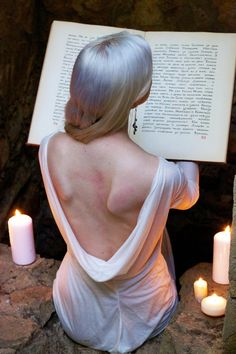 By candlelight, a Winter Queen holds court and studies the ancient ways lest they be forgotten..