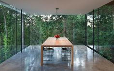MINIMAL DINING ROOM   A Dining Room Surrounded By Glass Hangs Off The Side Of This House  www.bocadolobo.com #diningroomdecorideas #moderndiningrooms
