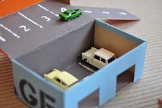 Toy car garage using a shoe box.  SO fun! #matchboxcars