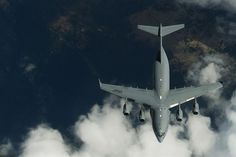 Members of the 191st Air Refueling Squadron conduct air refueling operations with a Boeing C-17 Globemaster III from Joint Base Lewis-McChord, Wash., Sept. 9, 2013. The 191st ARS routinely supports air operations across the western United States from their home station in Salt Lake City. (U.S. Air Force photo/Staff Sgt. Tim Chacon