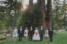 casual and colorful wedding party by the redwood trees