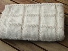 Knit. This would be a great baby blanket, maybe in comfort. Looks fairly easy just knit and purl :)