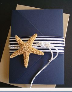 i like the navy color and white rope accent