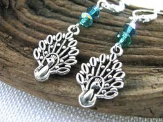 Nature Series:  Silver Filigree Peacock with Blue Green Crystals Dangly Bird Lovers Earrings - pinned by pin4etsy.com