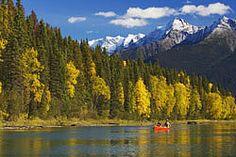 Bowron lake canoe circuit, Canada.  Amazing place to canoe/kayak, scenery is amazing.  :)