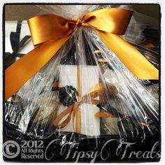 Gourmet Gift Basket from Tipsy Treats™ with alcohol-infused cupcakes, Tipsy Truffles™ and champagne.