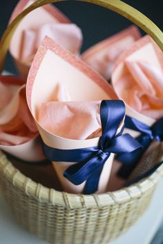 Peach or Coral + Navy Color Palette    Cone for Petal Toss    On SMP Weddings: http://www.StyleMePretty.com/new-england-weddings/2014/02/11/intimate-cape-cod-wedding/ Kate Preftakes Photography