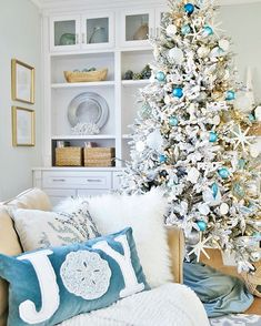 Coastal White Christmas Family Room - Sand and Sisal : Coastal Christmas Pillows - Coastal White Christmas Tree. Beach Christmas Trees, Coastal Christmas Decor, Nautical Christmas, Decoration Christmas, Coastal Decor, Christmas Home, Christmas Ideas, Christmas Crafts, Christmas Mantles