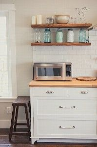 Open kitchen shelving - natural wood floating shelves against white tiles....decisions decisions x