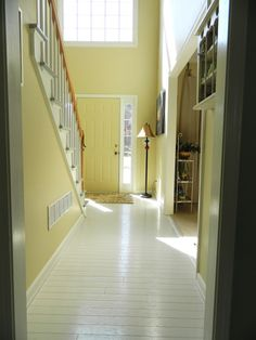 """Hardwood floors painted light gray with an amazingly durable product called """"Breakthrough""""  made by Porter. Hardwood floors never looked so good! The product is supposed to stick to any surface. $90 did her whole house."""