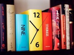 Book clock! Blends in with your other books all 007-esque. [Except, I organize my books by height and author.]