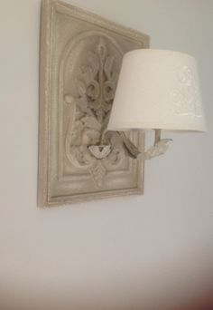 Carved rustic wall lamp with natural shade