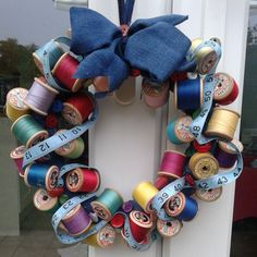 A door wreath for my Christmas Open Studio. The ring is made from plastic carrier bags sellotaped together, wrapped firmly with tape then wrapped with torn strips of old denim jeans. Finally, used the glue gun to stick on my collection of old cotton reels, a measuring tape and some buttons. I'm quite a bit in love with it and it cost me almost nothing :)