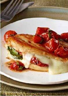 Mozzarella-Basil Chicken with Roasted Tomatoes -- Chicken breasts are stuffed with fresh basil, melty mozzarella and sun-dried tomatoes. The best part? It's a healthy living recipe too!