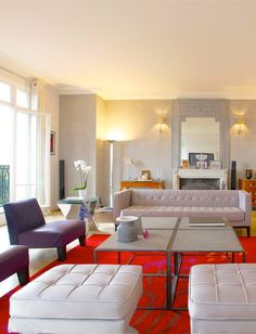 Purple and red accents add excitement and color to this Parisian apartment (Paris, France | Emile Garcin Properties)