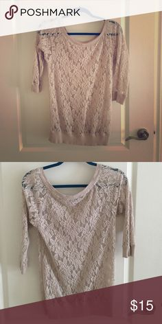 See through lace sweater shirt All lace, see through. Designed to be worn over a tank or bra top. Mid length sleeve. Express Tops Camisoles