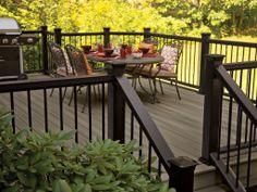 Pro-Tect Decking in Gray Birch with Black Mission Railing and Black Balusters | fiberondecking.com