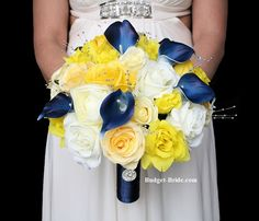 Marine Navy Blue with Bright yellow roses, white roses and silver pearls.  With handle on bouquet in navy marine blue