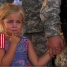 Story behind this? Her dad was leaving on a 2 year deployment. She was crying, and wouldn't let go of her dad's hand, even when he stood in line, saluting. No one had the heart to break them apart. Gives me chills