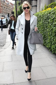 Keeping it covered: Kate Upton kept her model figure under wraps in a grey coat in London ...