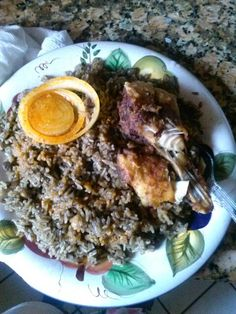 Haitian food fish with rice dried mushrooms and pigeon peas :)