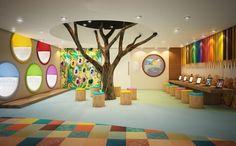 Uma brinquedoteca divertida e diferente! Para quem tem espaço de sobra para dedicar à esse espaço é perfeita. Os nichos coloridos para descanso são lindos, e a ideia da roda ao entorno da árvore é um jeito bacana de reunir as crianças. O recorte no forro ajuda a criar a ilusão de estarmos realmente ao entorno de uma árvore, como se estivéssemos no parque. Trazer um pouco da natureza para esses espaços pode ser uma ótima alternativa.: