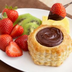 Sharing isn't necessary when you fillindividual puff pastry shells withthis exquisite chocolate fondue. Serve with fresh fruit and everyone can enjoy their own dessert. Comments