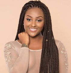 Long brown box braids hairstyle