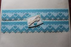 Its a Boy paper and stickers. Layered double heart chain on top of diamond zig zag on top of scallop stitch.