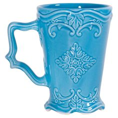 Martine Ceramic+mug+with+scrolled+details+in+a+turquoise+glaze.  +++Product:+MugConstruction+Material:+Ceramic