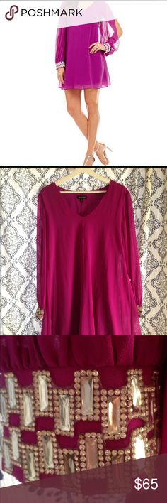 Fuchsia Jodi Kristopher Baby Doll Dress ⭐️NWT⭐️ Need a dress for a cocktail event or a dance?! This hot little number will definitely get you noticed. Embellished cuffs and a slit up the arm for a sexy feel. Jodi Kristopher Dresses Mini
