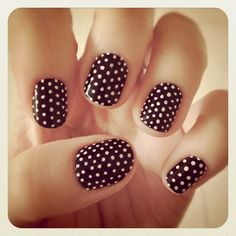 A million brown polka dot nails.