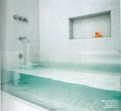 Make a Big Splash:  Clear Glass Tub by Stern McCafferty. Boston Home Magazine via Apartment Therapy.
