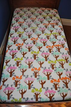 Baby Crib or Toddler Bed Sheet in Pastel Trees and Squirrels (we do custom work). $35.00, via Etsy.