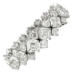 GIA Cert Asscher Cut Diamond Platinum Bracelet    From a unique collection of vintage tennis bracelets at…