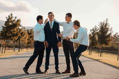 A beautifully joyous wedding in the cape winelands with the best people! Groomsmen Poses, Groom And Groomsmen, Printed Gowns, Run Around, Reception Areas, Kinds Of People, Cape, Bridesmaid, In This Moment