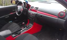 My 07 Mazda 3 GT Interior Mods, Some Is Paint With Clear And The Other Red  Carbon Fiber Wrap, Mazda Logo Cut To Form The Evil M Logo Throughout And  Some ...
