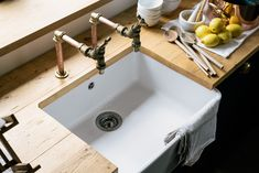 A Villeroy & Boch Farmhouse sink with upcycled garden taps and a worktop made from reclaimed scaffolding