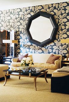 graphic and lively wallpaper, geometric screen, octagonal mirror, and gold accents | Domino