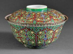 A Chinese Polychrome Porcelain Covered Bowl, probably Qing Dynasty (1644-1911), decorated with floral panels and swags in thick overglaze enamels, height 5 in., diameter 8 1/8 in