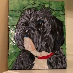Unique Pet Portrait of your dog or cat. A creative way to honor or memorialize your favorite fur baby. You provide me with pictures of your pet and I will create a 10 inch by 12 inch mosaic portrait of your pet. The portrait is created from pieces of stained glass that are used to create the fur and facial features of your unique baby. I will create a portrait that brings your baby to life not just a generic dog picture. These portraits glow in the light as the light bounces off of the…
