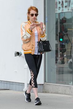Emma Roberts wearing Balenciaga Mini Papier A4 Bag, New Balance Fresh Foam Zante V2 Sneakers, Ray-Ban Rb4246 Clubround Sunglasses and Sonix Pinata Iphone Case